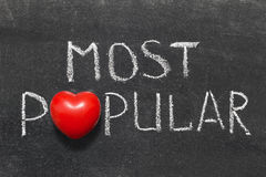 Most popular. Phrase handwritten on blackboard with heart symbol instead of O Royalty Free Stock Photos