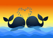 Most romantic in sea. Two whales kiss on the waves in the ocean Stock Photos