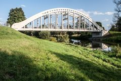 Most Sokolovskych hrdinu concrete bridge with Olse river in Karvina city in Czech republic. During nice day with blue sky and only few clouds Royalty Free Stock Photo