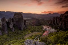 Amazing view of the Meteora site in Greece at sunset with one  m. This is the most spectacular place in Greece. The huge rock formations at Meteora, Greece are Royalty Free Stock Photo