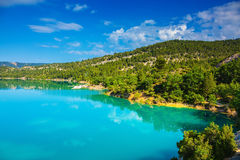The most spectacular Verdon Canyon. V The most spectacular in  French Alps - Verdon Canyon.  Spring Provence. Azure water reflects the clouds Stock Photos