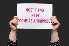 Most Thing in life come as a surprise. Motivational sign stock photography