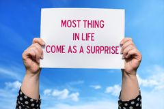 Most Thing in life come as a surprise. Motivational sign stock photo