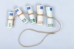The most used euro bills for Europeans tied with a rope and isol. Ated on white background Royalty Free Stock Photography