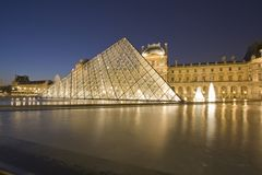 The Louvre of Paris by night. The most visited museum in the world, Louvre in Paris, France magnificent illuminated at twilight, as seen from the Denon Wing. Its stock photos