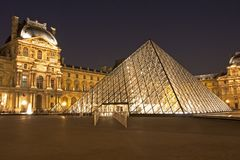 The Louvre of Paris by night. The most visited museum in the world, Louvre in Paris, France magnificent illuminated at twilight, as seen from the Denon Wing. Its stock image