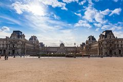 Louvre Museum Paris. The most visited museum in the world, Louvre in Paris, France magnificent illuminated at twilight. Its history goes back 800 years of royalty free stock photography