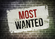 Most Wanted. Dirty poster on wall concept Royalty Free Stock Image