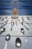 Most wanted muffin and a flock of spoons Royalty Free Stock Image