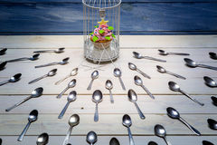 Most wanted muffin and a herd spoons Stock Images