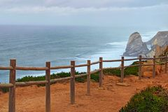 The most western part of Europe is famous Cape Roca Cabo da Roca, Portugal. Panoramic view of beautiful landscape. With stormy Atlantic Ocean and high cliffs stock photos