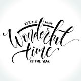 The most wonderful time of the year lettering. It is the most wonderful time of the year. Greeting card with modern calligraphy. Brush painted letters, vector Stock Photos