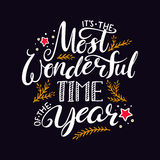 The most wonderful time of the year. Hand written christmas lettering on black background Royalty Free Stock Photography