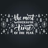 The Most Wonderful Time Of The Year lettering on festive background. Vector hand drawn Christmas illustration. Happy Holidays greeting card, poster template Royalty Free Stock Photos