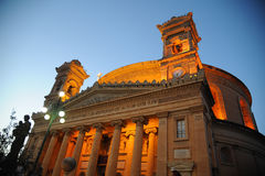 Mosta Dome at dusk. Mosta, Malta. Mosta town square filled with revellers for the Easter passion of christ parade. Mosta Dome was built in 1860 over another stock photo