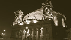 Mosta Dome by night, sepia. MALTA - 11 JAN 2016: Mosta Dome by night, Malta, Rotunda of Mosta, The Church of the Assumption of Our Lady, sepia tone Stock Image