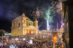 MOSTA, MALTA - 15 AUG. 2016: Fireworks at the Mosta festival at. Night with the famous Mosta Dome and the People of Malta are celebrating the Feast of the Royalty Free Stock Photo