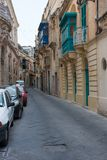 Narrow streets and colorful balconies. Malta. MOSTA, MALTA - AUGUST 21, 2017: The narrow streets with their colorful balconies of Mosta are one of the major Stock Image