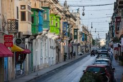 Narrow streets and colorful balconies. Malta. MOSTA, MALTA - AUGUST 21, 2017: The narrow streets with their colorful balconies of Mosta are one of the major Stock Photography
