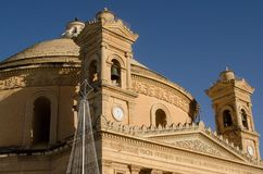 MOSTA, MALTA ,15 DECEMBER 2018 - Mosta Dome Cathedral St. Mary church The Parish Church of Assumption. Under the blue sky , rotunda square stock photo