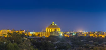 Mosta, Malta - The Mosta Dome at night. Mosta, Malta - The Mosta Dome or The Church of the Assumption of Our Lady by blue hour on a panoramic skyline shot Royalty Free Stock Images