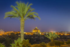 Mosta, Malta - The Mosta Dome with palm tree by night. Mosta, Malta - The Mosta Dome or The Church of the Assumption of Our Lady, commonly known as the Rotunda Stock Images