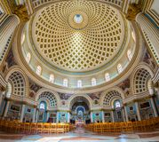 Mosta, Malta - Panoramic interior shot of Mosta Dome. Panoramic interior shot of Mosta Dome in Mosta, Malta. Church of the Assumption of Our Lady known as Royalty Free Stock Photos
