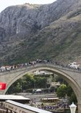 Crowd of people of the famous Mostar bridge in summer season. MOSTAR, BOSNIA AND HERZEGOVINA - AUGUST 17 2017: Crowd of people of the famous Mostar bridge in Royalty Free Stock Photos