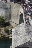 View from the top of the historic Mostar bridge crowded with people. MOSTAR, BOSNIA AND HERZEGOVINA - AUGUST17 2017: View from the top of the historic Mostar Stock Photo