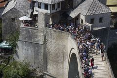 View from the top of the historic Mostar bridge crowded with people. MOSTAR, BOSNIA AND HERZEGOVINA - AUGUST17 2017: View from the top of the historic Mostar Royalty Free Stock Photos