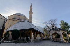MOSTAR, BOSNIA AND HERZEGOVINA- JAN 26, 2018: Mehmet Pasha Mosque panorama and fountain Gazebo in Mostar city center Stock Photo