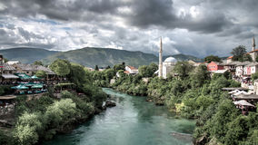 Mostar, Bosnia Herzegovina - May 1, 2014: Nerteva River and Old City of Mostar, with Ottoman Mosque Royalty Free Stock Photography