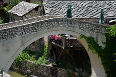 Mostar, Bosnia Herzegovina. Old ottoman bridge. A medieval bridge in the old town of Mostar in Bosnia Herzegovina. River Neretva and the ottoman old village Royalty Free Stock Image