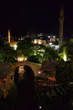 Mostar, Bosnia Herzegovina. The old town ninarets by night. The old town of Mostar in Bosnia Herzegovina, night view of the ottoman medieval town minarets Royalty Free Stock Images