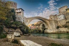 Mostar, Bosnia and Herzegovina. Stone bridge over river between Catholic and Muslim regions of Bosnia, Herzegovina Royalty Free Stock Photos