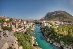 Mostar: both sides of the river. Mostar is the cultural capital in southern Bosnia and Herzegovina.  The city is split by the Neretva River and is connected by Royalty Free Stock Photography