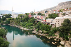 Mostar bridge. MOSTAR, BOSNIA - AUGUST 9: View of old town from Stari Most bridge on August 9, 2012 in Mostar, Bosnia. This old town founded in 1452, was mostly Royalty Free Stock Image