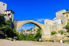 Mostar bridge, Bosnia. Mostar new bridge renovated after war, tourists visit and take picture, Bosnia Royalty Free Stock Photos