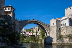 The Mostar Bridge. Tourists visit the Old Bridge on April 15, 2015 in Mostar in Bosnia and Herzegovina. Destroyed in 1993 during the Croat–Bosniak War, the Old Royalty Free Stock Images