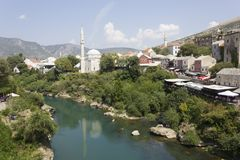Mostar city as seen from its famous Old bridge. MOSTAR, BOSNIA AND HERZEGOVINA - AUGUST 17 2017: mostar city as seen from its famous Old bridge Royalty Free Stock Images