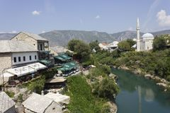Mostar city as seen from its famous Old bridge. MOSTAR, BOSNIA AND HERZEGOVINA - AUGUST 17 2017: mostar city as seen from its famous Old bridge Stock Photos