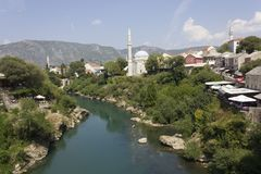 Mostar city as seen from its famous Old bridge. MOSTAR, BOSNIA AND HERZEGOVINA - AUGUST 17 2017: mostar city as seen from its famous Old bridge Royalty Free Stock Photo