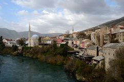 Mostar city with mosque minaret medieval architecture Neretva river Bosnia Herzegovina Stock Image