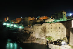 Mostar by night. Famous touristic place Mostar viewed from The Old Bridge by night Stock Photo
