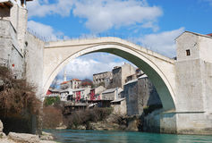 Mostar Old Bridge. Old Bridge in Mostar, Bosnia and Herzegovina with the old town and blue sky in background Stock Photo