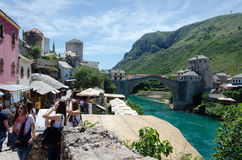 Mostar. Three Young Woman. MOSTAR, BOSNIA AND HERZEGOVINA - MAY 18, 2013: Three young woman tourists in Mostar. In the background is the bridge over the Neretva Royalty Free Stock Photos