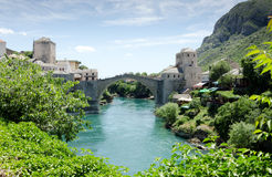 Mostar Town and Bridge. The historic town of Mostar, spanning a deep valley of the Neretva River, developed in the 15th and 16th centuries as an Ottoman frontier Royalty Free Stock Image