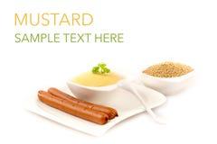 Mostarda e salsicha tipo frankfurter Fotos de Stock