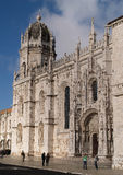 Mosteiro dos Jeronimos. LISBON - DECEMBER 31: Tourist enjoy visiting the Mosteiro dos Jeronimos, a symbol of Lisbon, listed in UNESCO World Heritage Site, on Stock Photo