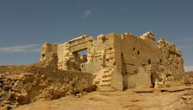 Oracle temple of Amun , Siwa Egypt. In the mostly abandoned village of Aghurmi in the Siwa Oasis is a most famous temple of Amun, now more known as the Temple of Stock Photography
